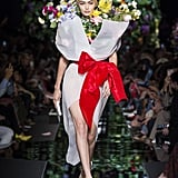 Gigi Hadid Dresses as a Flower Bouquet For Moschino