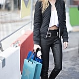 With Coated Jeans, a Plain Crop Top, and Bomber Jacket
