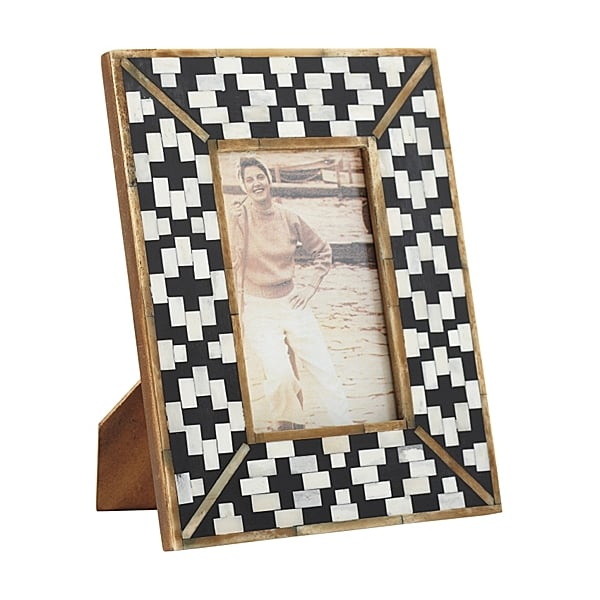 We love the idea of gifting a hostess with a sleek frame, like Serena and Lily's Bone Inlay Frame ($28) — she can pop in a photo from the party the next day.