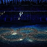The dancers formed the shape of four Olympic rings and one stubborn snowflake — a nod to the snowflake malfunction in the opening ceremony.