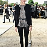 Olivia Palermo was sleek in black leather pants, a metallic peplum blouse, and a collarless cardigan outside Elie Saab's Spring 2014 show.