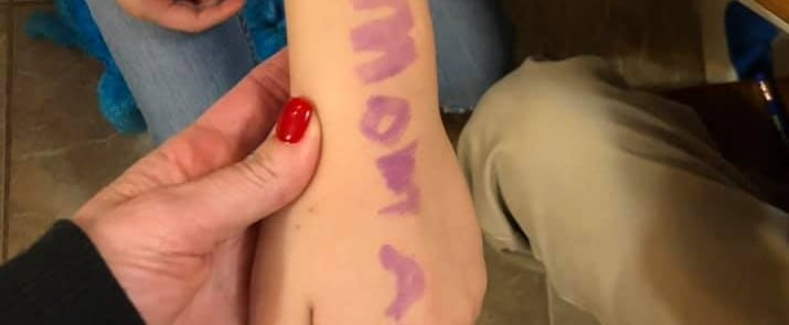 Girl Wrote Message on Arm During School Lockdown