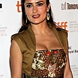 Americano star Salma Hayek wore a chic sleeveless dress.