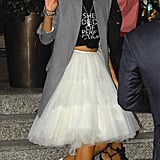 The trendsetter took a romantic tulle skirt and turned it on its head — pairing it with a knotted tee, oversize blazer, and bow-detail pumps in London.