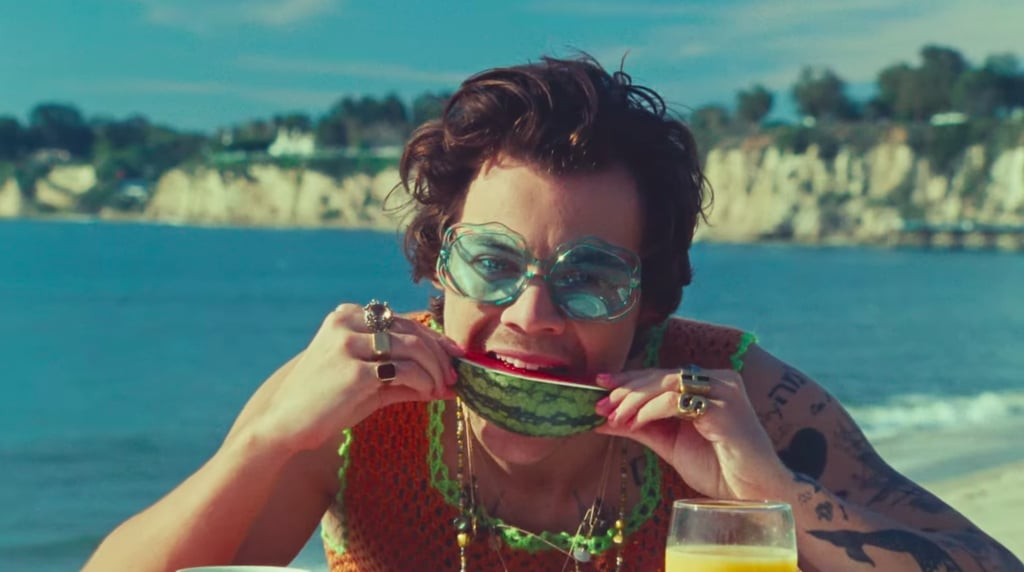 "What did Harry Styles know that we didn't? The singer and hedonistic heartthrob recently released the music video for ""Watermelon Sugar"" off his sophomore album, Fine Line, and it's inadvertently (or intentionally) acting as a balm for our current collective existence, filled with all the comforts we're yearning for: beach outings, packed picnics, sharing food with friends, affection. In fact, it's even plainly stated at the beginning that the video is ""dedicated to touching""!  Of course the video was filmed months ago — before ""social distancing"" became part of our regular lexicon — but it somehow feels prescient. Styles knew we'd need some semblance of a summer, particularly as we grapple with the understanding that summer will look a whole lot different this year. Existential philosopher Albert Camus once wrote, ""In the depth of winter, I finally learned that within me there lay an invincible summer."" Amid a pandemic, Styles is illuminating the invincible summer within us all. The video is also really horny. (I'm sorry, but it needed to be said.) One has to assume that Styles has seen Call Me by Your Name, because it certainly puts forth the message that the watermelon is to Styles what the peach was to Elio. Sprinkled in are truly stunning shots of the babeliest babes as they sunbathe or feed Styles the titular fruit. There's a lot of caressing, watermelon juice everywhere, and, of course, the unflinching shot of Styles stroking the edge of a watermelon that momentarily destroyed the internet before bringing it back to life.  Music videos of this scale and anticipation often generate buzz here at POPSUGAR, but editors had feelings about this one. Ahead, enjoy our most pressing questions, comments, and concerns.      Related:                                                                                                           BRB, Admiring Harry Styles's ""Watermelon Sugar"" Music Video Outfits — Don't Text"
