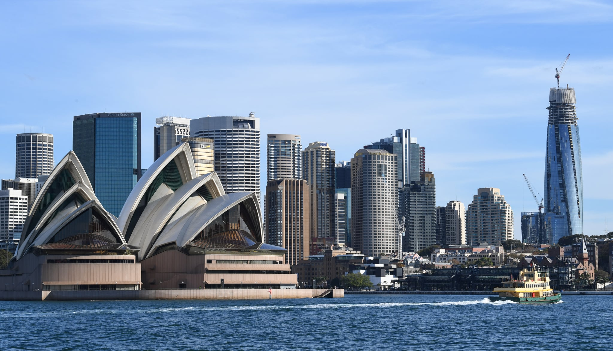 SYDNEY, AUSTRALIA - MAY 12: A Sydney ferry passes the Opera House and skyline of the CBD area on May 12, 2020 in Sydney, Australia. There were no new coronavirus infections recorded in New South Wales for the first time since the pandemic began. 6,048 residents were tested in the 24 hours to 8pm on May 11, 2020 and NSW Premier Gladys Berejiklian said it was a major milestone in the state's fight against the virus. (Photo by James D. Morgan/Getty Images)