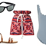 Marysia Palm Springs One-Piece Swimsuit ($349). Valentino Bandana Print Shorts ($1,490). Ray-Ban Original Wayfarer Polarized Sunglasses ($203). Mango Leather Strap Sandals ($60).