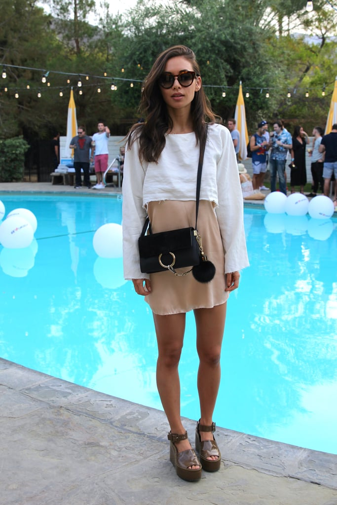 Rumi Neely showed off separates from her own collection. She wore a Rumi satin slip dress beneath a lightweight distressed crop top and finished her outfit with a Céline bag and Chloé patent leather platforms.