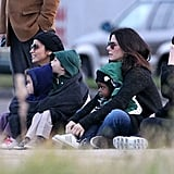 Sandra Bullock had Louis Bullock in her lap as she sat next to Camila Alves and the McConaughey kids in New Orleans.