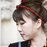 A headband can be an interesting way to add texture to your style; just take this roped look as an example.