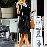 Delta Goodrem flashed a peace sign to photographers after having dinner with a male friend in Beverly Hills on Jan. 22.
