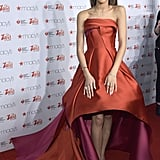 Zendaya slipped into a dramatic high-low strapless gown for the Red Dress Collection show during New York Fashion Week.