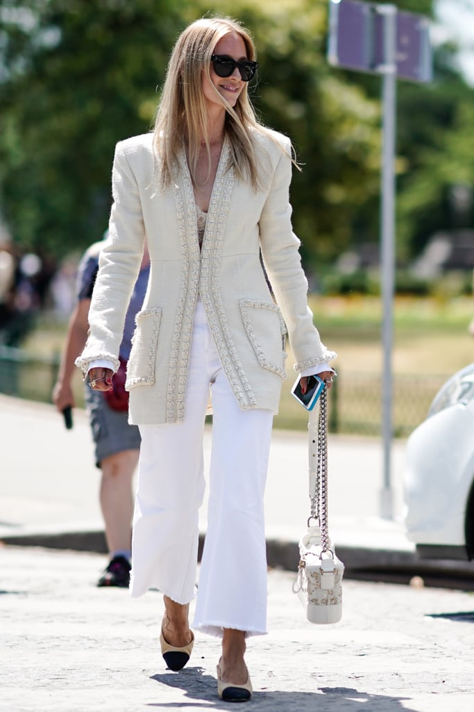 Create a look with varying tones, like off-white and ivory, and keep your blazer buttoned for a more polished effect.