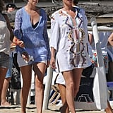 Kate Moss looked beach-ready in a white tunic.