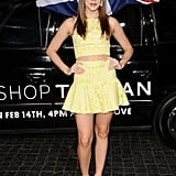 Christa B. Allen showed off her midriff in a bright yellow crop top and flared miniskirt. Her white pumps contrasted the color on top with something a bit more classic on bottom.