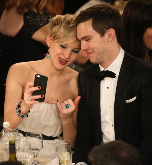 Jennifer-Lawrence-Nicholas-Hoult-took-selfie-table