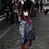 Olivia looked glamorous in a fuzzy scarf and high boots while visiting London.
