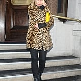 Kate Moss carried a yellow clutch.