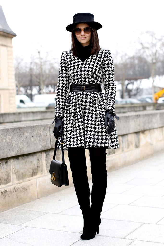 A houndstooth-print white and black coat gave over-the-knee boots more polish.