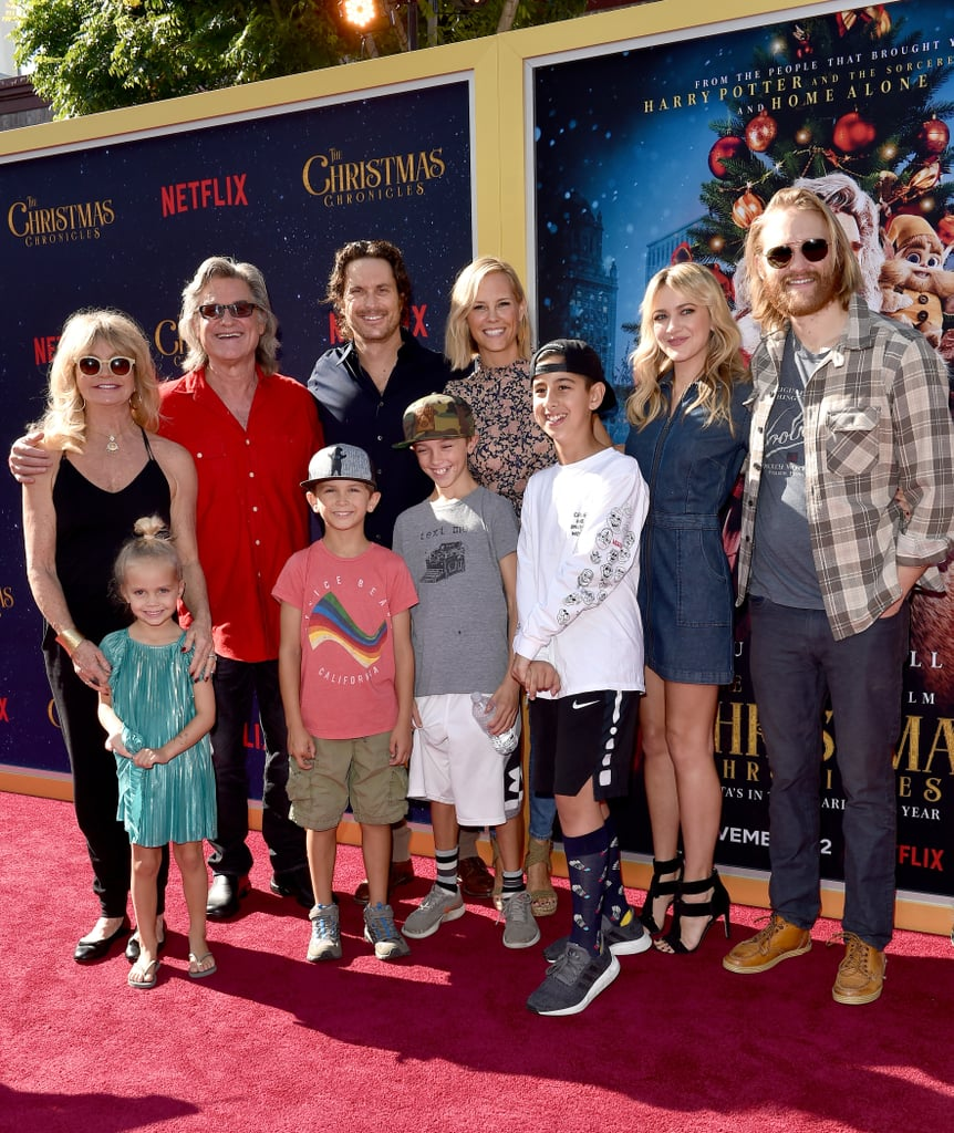 "Kurt Russell had the support of his loved ones as he attended the LA premiere of his new movie The Christmas Chronicles on Sunday. The actor, who is playing Santa Claus in the Netflix original, was surrounded by his big, happy family as he walked the red carpet. In addition to cuddling up to his longtime love, Goldie Hawn, the couple also posed for a handful of photos with their kids and grandkids, including Wyatt Russell and his girlfriend Meredith Hagner, as well as Oliver Hudson and his wife Erinn Bartlett with their kids, Wilder, Bodhi, and Rio. Kurt even shared a precious moment with his mother, Louise Julia Russell, as he gave her a kiss on the cheek.  Noticeably absent from the group was Kate Hudson, who recently gave birth to her third child. While the actress wasn't able to attend Kurt's premiere, she did share a cute moment with her ""Pa"" during a special dinner in LA earlier this month. Keep scrolling for even more sweet family moments ahead.       Related:                                                                                                           Kurt Russell and Goldie Hawn's Modern Family Is Absolutely Golden"