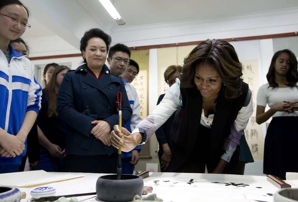 First Lady Michelle Obama practiced traditional Chinese calligraphy in Beijing.