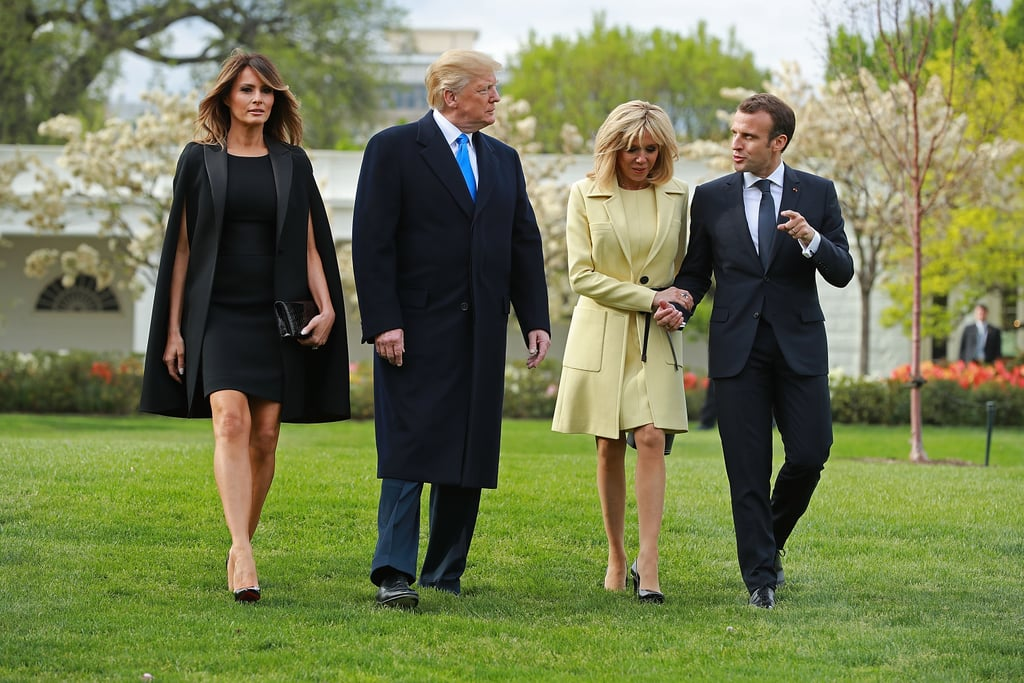 While welcoming the French president and his wife on April 23, Melania wore a Givenchy cape. It definitely made a style statement as everyone walked across the lawn.