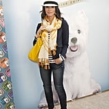 Skinny Ksubi jeans, a bright scarf and bag, and a stylish Panama hat make for a cute daytime look.
