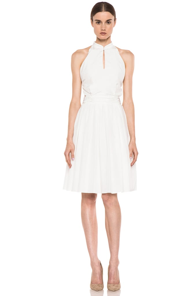 All I want to do when it's hot and sticky outside is live in a pretty white dress — and at least try to appear more polished than I actually feel. This Boy. by Band of Outsiders white cutout shirt dress ($695) maintains a ladylike silhouette, but the cool cutouts feel just a little sexy — not to mention, they will help combat the heat.  — HW