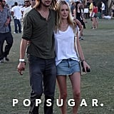 Kate Bosworth and James Rousseau cuddled up during Coachella in 2009.