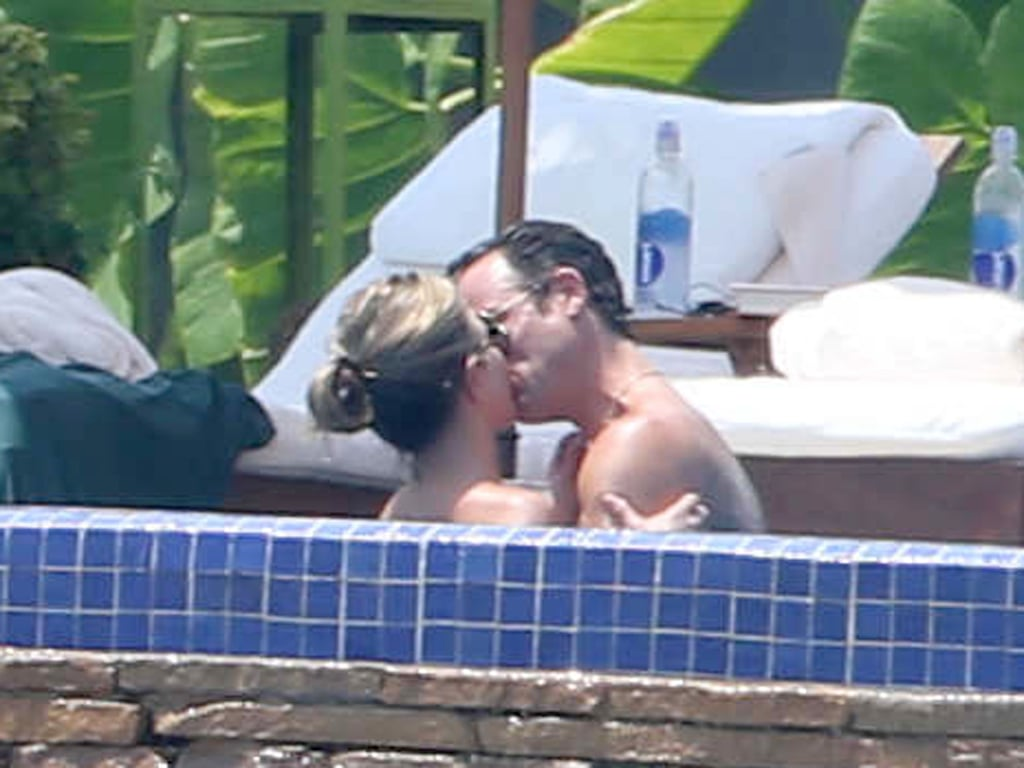 Jennifer Aniston gave fiancé Justin Theroux a steamy kiss in the jacuzzi.
