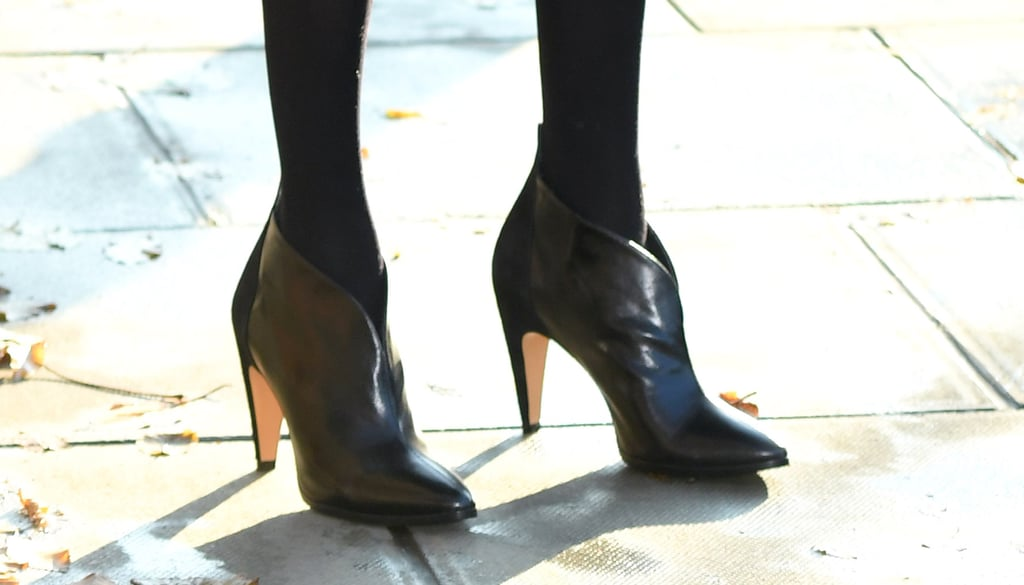 The duchess added some edge to the look with a pair of Givenchy leather ankle boots.