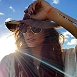 Sun, hats, and flash tats.