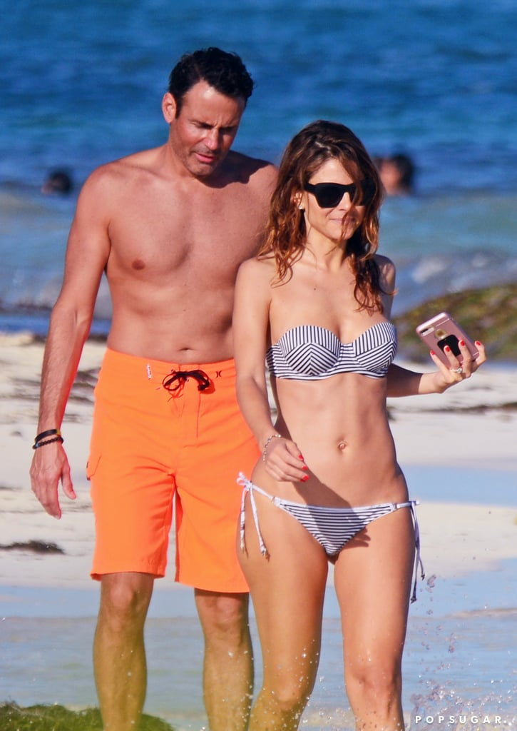 """Maria Menounos and her fiancé, Keven Undergaro, spent an afternoon enjoying the sun and surf during their vacation in Mexico on Thursday. The couple, who have been dating since 1998 and got engaged back in March, showed their love for each other while kissing and snapping selfies in front of the picturesque background. Keven couldn't keep his hands off of the E! News anchor, who showed off her figure in a sexy striped bikini. Maria also shared photos of their romantic getaway on Instagram, writing, """"Soakin' in the sun...#heaven #mexico.""""      Related:                                                                                                           Look Back at Last Year's Hottest Swimsuit Moments"""