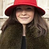 A red wool hat was the ideal accompaniment to a moss green fur coat.
