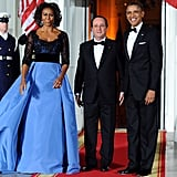 Michelle Obama wowed in a Carolina Herrera gown upon welcoming the French president for the dinner.