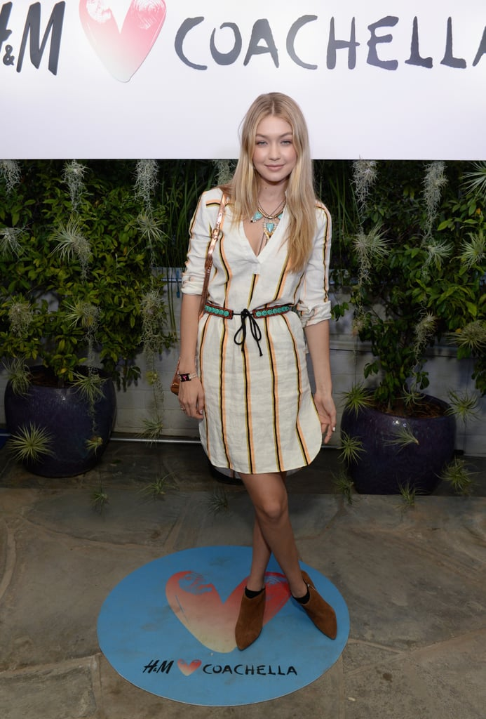For a nighttime party, Gigi worked a striped linen dress from H&M, contrasting its mustard palette with a turquoise belt. She added edge in the form of a spiked collar necklace and metallic shoulder bag, finishing her look with suede pointed-toe shoes.