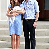 For her first post-baby appearance, on July 23, Kate Middleton channeled the late Princess Diana in a custom-made blue polka-dot Jenny Packham dress as she cradled the royal baby outside St. Mary's Hospital.
