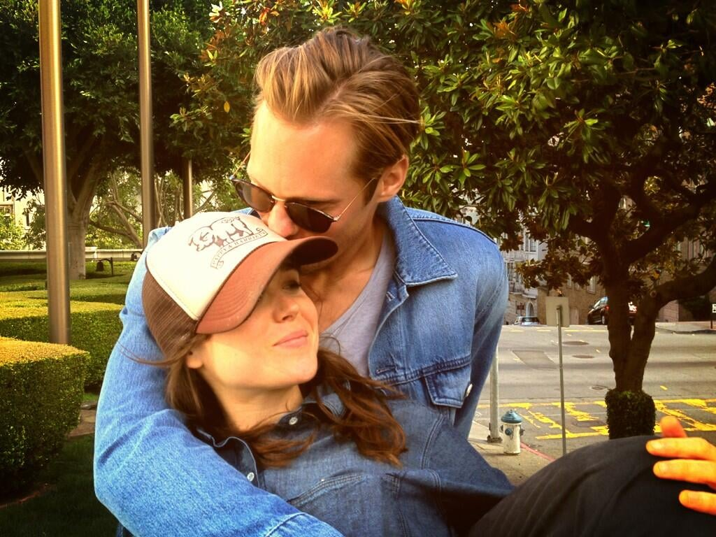 """Alexander Skarsgard shared a snuggle with his The East costar Ellen Page on Saturday. Their director, Zal Batmanglij, tweeted a photo of the onscreen couple nuzzling each other and wrote, """"This reminds me of shooting. When we'd lie on the grass listening to Toby [Kebbell] practice Rostam's piano piece."""" Ellen joked about the photo on her Twitter, calling it a """"Canadian tuxedo party"""" because of her and Alex's denim outfits. Later, Ellen, Alexander, and Zal traveled to LA where they went their separate ways after arriving on the same flight.  Rumors have been swirling for months that Alexander and Ellen are dating, but neither star has publicly confirmed the relationship. Whatever their status, the two have been hanging out a lot as they have been gearing up for press duties for The East, which is currently in theaters in limited release. Alexander had dinner with Ellen and their costars in NYC last month ahead of the film's premiere.  Source: Twitter user z_al"""