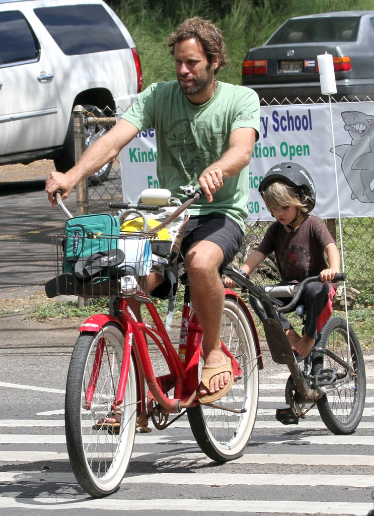 Jack Johnson and his son were spotted out riding their bikes in Oahu on Thursday. He and his wife, Kim, and three children live on the Hawaiian island, where Jack was born and raised. He's hanging around near home during a break from his world tour since he was forced to cancel the remainder of his Japan appearances due to the earthquake. The singer will be back on the road in May though, to play in South America, Spain, and Italy. Jack's travels mean that the annual April music festival that he and Kim founded will be put on hold this year, after six successful events.