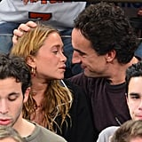 Mary-Kate Olsen and Olivier Sarkozy kissed in the stands.