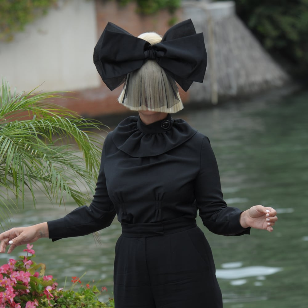 Pictures of Sia Furler Covering Her Face and Wearing Wigs
