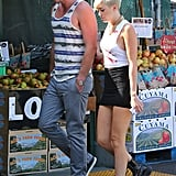 Miley Cyrus wore a tank with a short black skirt to go grocery shopping with Liam Hemsworth in LA.