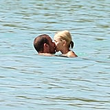 Naomi Watts and Liev Schreiber kissed in the water in Barbados.