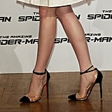 Hello, cap-toe perfection! We love that she rocked these clear-infused Christian Louboutin ankle-strap pumps with her LWD in Rome.