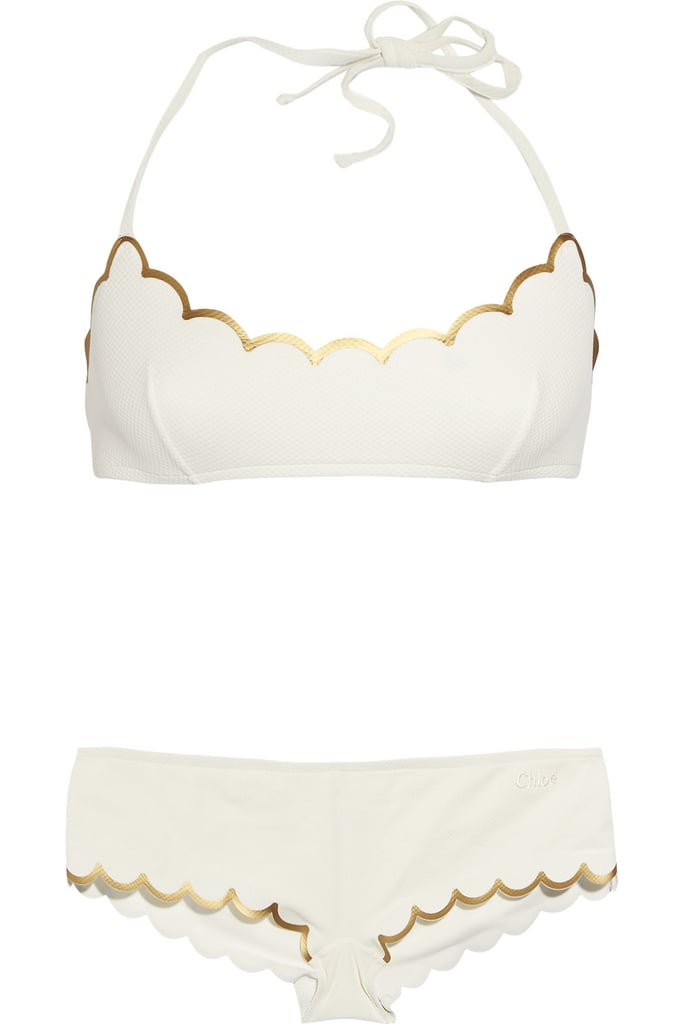 Gold and white always makes for a cute color story, and the scalloped edges on this bikini give off a sweet, girlie vibe. Chloé Scalloped Halterneck Bikini ($287, originally $410)