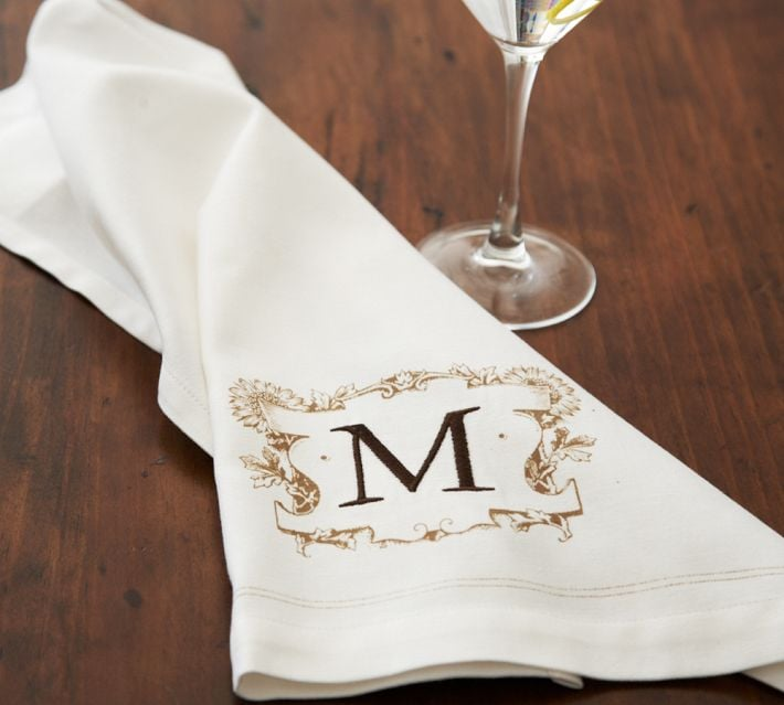 This set of two bar towels ($19) is classic and convenient, and for $7 you can add the party planner's monogram. A great way to enhance the gift? Help with the dishes!