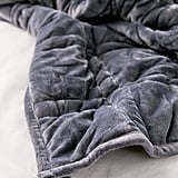 Urban Outfitters Is Selling a $139 Weighted Blanket