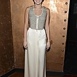 Miley Cyrus paired her studded top with a cream skirt.