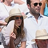In 2006, Jen wore gold-rimmed aviators alongside Vince Vaughn, who sported a similar style with a slightly larger frame at the French Open.