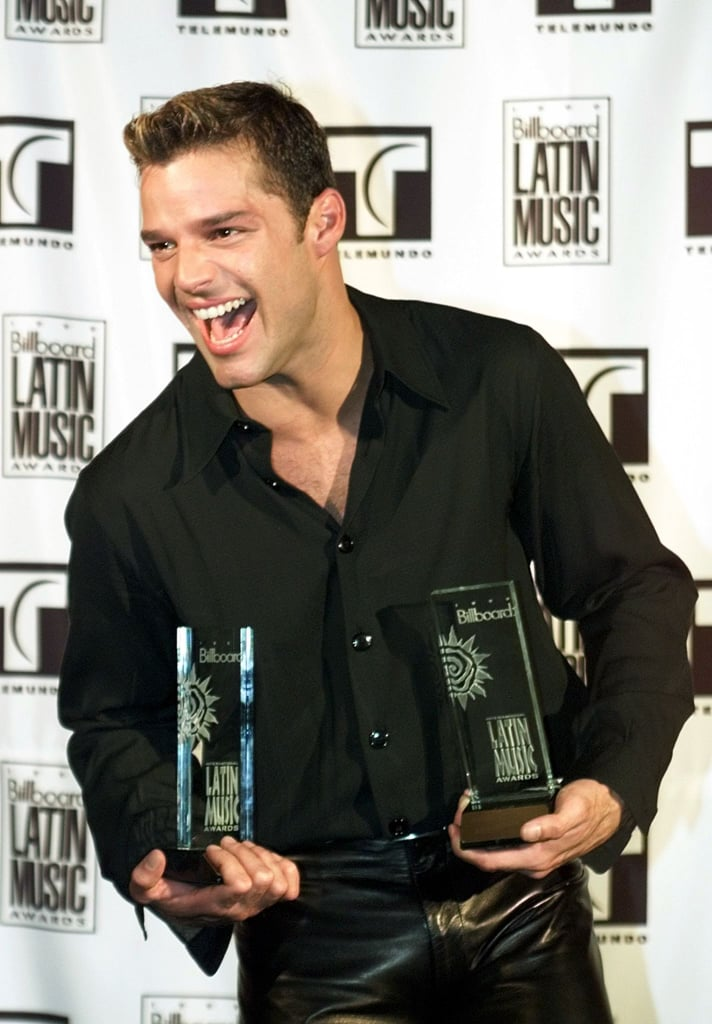 Ricky Martin got excited with his Billboard statues backstage in December 1999.